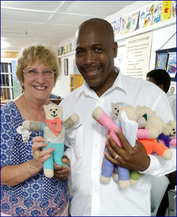 Photograph: Anne Thompson Rotarian ( Lutterworth Rotarian, Rose Chapman's sister) and Director of a local children's home in South Africa presenting Teddies for the children.