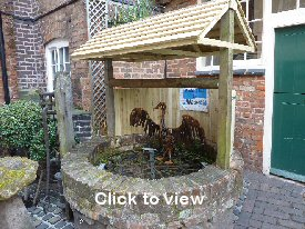 Photograph: The well at the Greyhound Coaching Inn in Lutterworth. Click to view an enlargement.